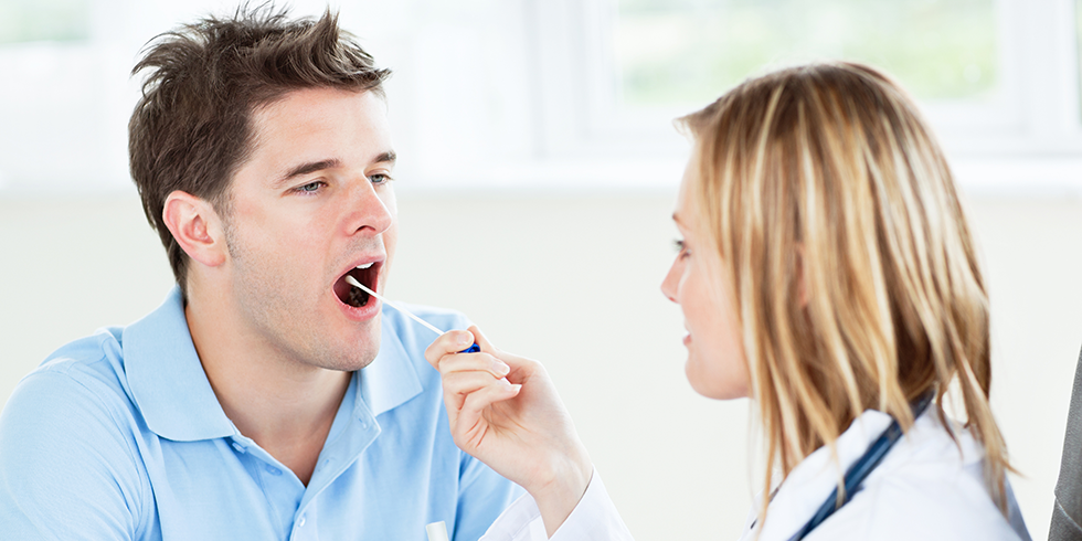 Image of health professional taking saliva sample